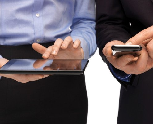 Two executives on handhelds