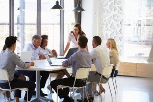 Consultants and stakeholder collaborating in meeting room