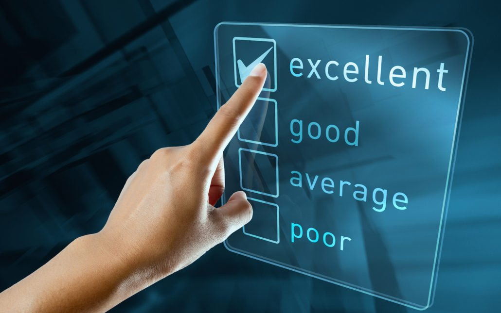 Person pointing to excellent on a scorecard