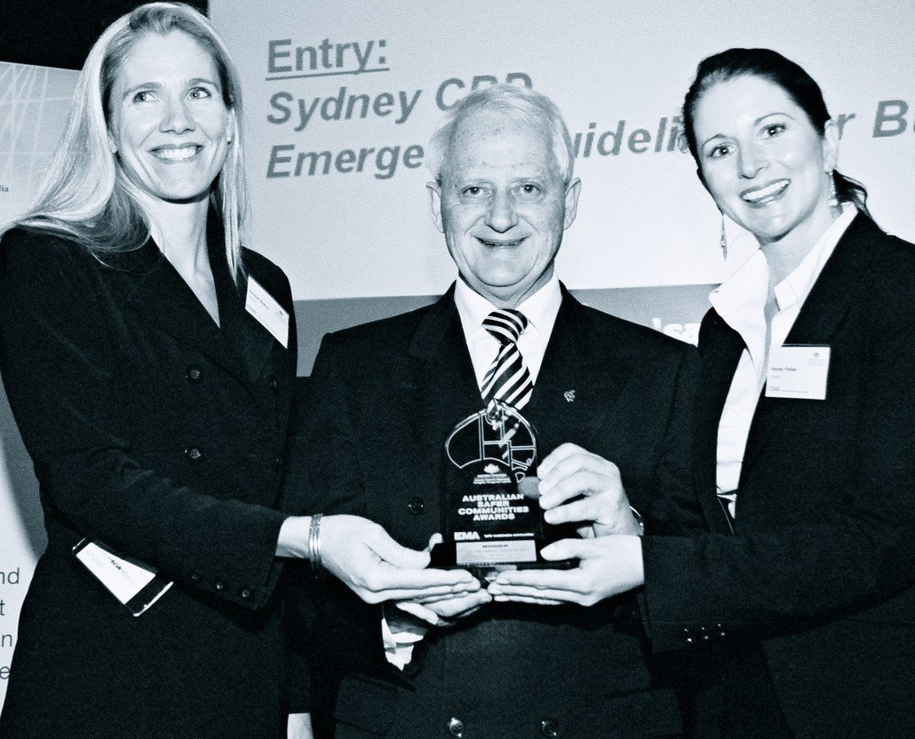 Natalie Botha and Hayley Parker from Janellis accepting National Award from Philip Ruddock